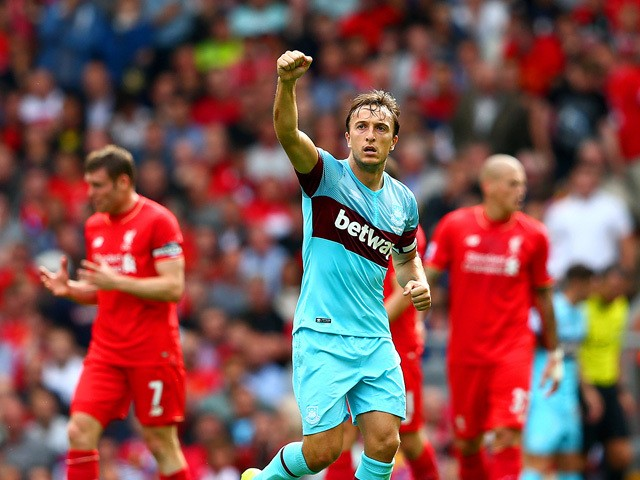 Mark Noble of West Ham United celebrates scoring his team's second goal from the penalty spot during the Barclays Premier League match between Liverpool and West Ham United at Anfield on August 29, 2015