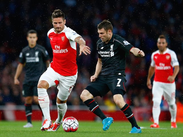 Arsenal's Olivier Giroud is pursued by James Milner of Liverpool on August 24, 2015