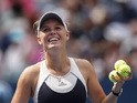 Caroline Wozniacki of Denmark hits balls to spectators after after defeating Jamie Loeb of United States during their 2015 US Open Women's Singles round 1 match at the USTA Billie Jean King National Tennis Center September 1, 2015