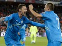 Slovenian forward Milivoje Novakovic (L) celebrates with team mate midfielder Josip Ilicic after he scored the team's first goal during the Euro 2016 qualifying football match between Switzerland and Slovenia at the St. Jakob park stadium in Basel on Sept