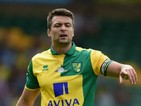 Russell Martin of Norwich City in action during the pre season friendly match between Norwich City and Brentford at Carrow Road on August 1, 2015 in Norwich, England.