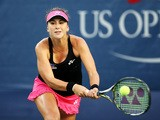 Belinda Bencic of Switzerland returns a shot against Misaki Doi of Japan during their Women's Singles Second Round match on Day Three of the 2015 US Open at the USTA Billie Jean King National Tennis Center on September 2, 2015