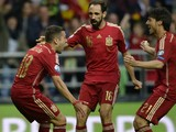 Spain's defender Jordi Alba (L) celebrates with teammates after scoring a goal during the Euro 2016 qualifying football match Spain vs Slovakia at the Carlos Tartiere stadium in Oviedo on September 5, 20