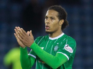 Virgl Van Dijk of Celtic applauds the fans after the game at the Scottish premiership match between Kilmarnock and Celtic at Rugby Park on August 12, 2015