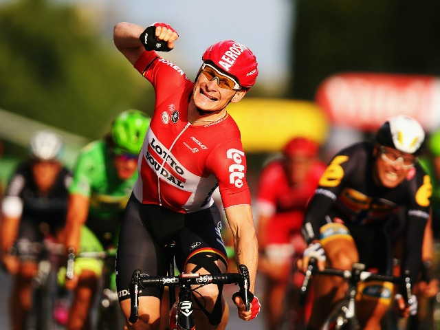 Andre Greipel of Germany and Lotto-Soudal celebrates as he crosses the finish line to win the twenty first stage of the 2015 Tour de France, a 109.5 km stage between Sevres and Paris Champs-Elysees, on July 26, 2015 in Paris, France.
