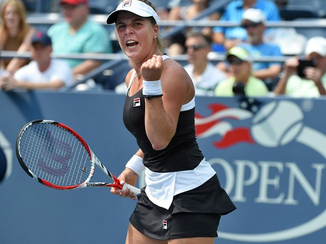 Anna Tatishvili of the US reacts winning a point against Karolina Pliskova of Czech Republic during their Womens Singles round 1 match of the US Open at USTA Billie Jean King National Tennis Center in New York on August 31, 2015