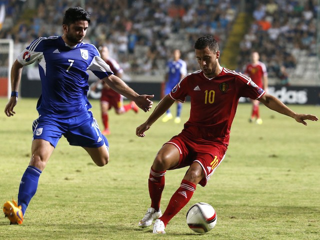 Belgium's Eden Hazard (R) dribbles the ball as Cyprus' Georgios Economides defends during their EURO 2016 qualifying football match between Cyprus and Belgium at the Neo GSP stadium in the Cypriot capital, Nicosia, on September 6, 2015.