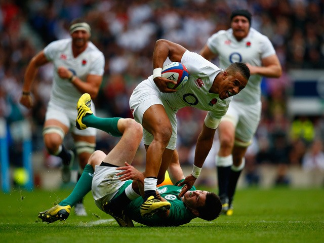 Anthony Watson of England breaks away from Jonny Sexton of Ireland during the QBE International match between England and Ireland at Twickenham Stadium on September 5, 2015