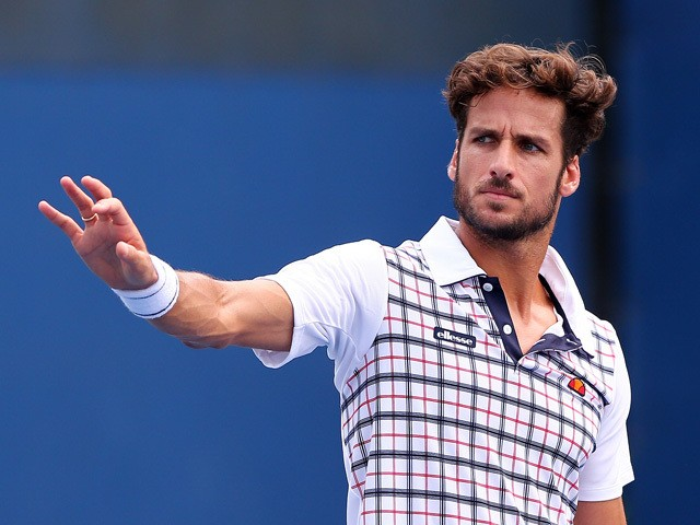 Feliciano Lopez of Spain gestures during a match against Nikoloz Basilashvili of Georgia in their Men's First Round match on Day One of the 2015 US Open at the USTA Billie Jean King National Tennis Center on August 31, 2015
