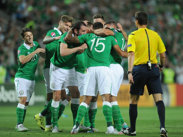 Cyrus Christie of Republic of Ireland celebrates with teammates after scoring Ireland's 1st goal during the UEFA EURO 2016 Qualifier between Gibraltar and Republic of Ireland at Estadio Algarve on September 4, 2015 in Faro, Portugal.