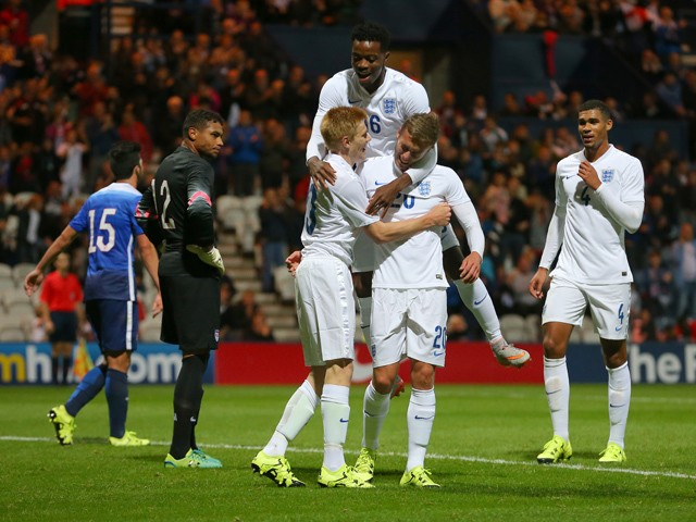 James Wilson of England celebrates with Duncan Watmore and Nathaniel Chalobah of England, (top) after scoring the first goal of the game during the International friendly match between England U21 and USA U23 at Deepdale on September 3, 2015