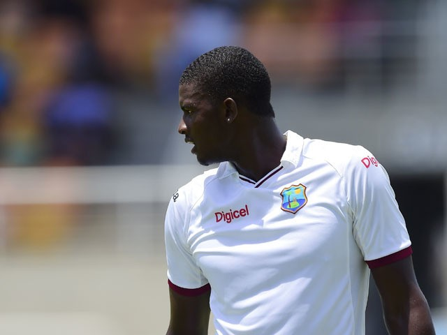West Indies' Jason Holder prepares to bowl on day three of the second cricket Test between Australia and the West Indies at Sabina Park in Kingston, Jamaica on June 13, 2015