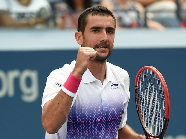 Marin Cilic of Croatia celebrates his win over Evgeny Donskoy of Russia during their 2015 US Open Men's singles round 2 match at USTA Billie Jean King National Tennis Center in New York on September 2, 2015. Cilic won 6-2, 6-3, 7-5. AFP PHOTO/JEWEL SAMAD
