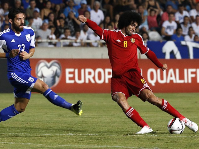 Belgium's Marouane Fellaini (R) dribbles the ball as Cyprus' Marios Nicolaou defends during their EURO 2016 qualifying football match between Cyprus and Belgium at the Neo GSP stadium in the Cypriot capital Nicosia on September 6, 2015.