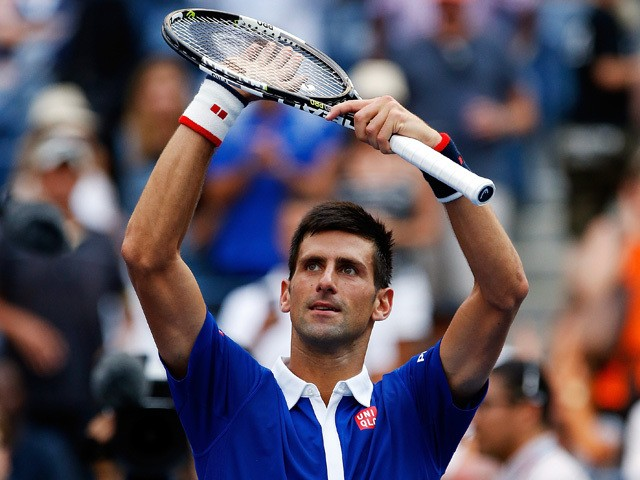 Novak Djokovic of Serbia celebrates after defeating Joao Souza of Brazil in their Men's Singles First Round match on Day One of the 2015 US Open at the USTA Billie Jean King National Tennis Center on August 31, 2015