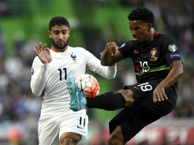 France's forward Nabil Fekir (L) vies with Portugal's defender Eliseu during the Euro 2016 friendly football match Portugal vs France at the Jose Alvalade stadium in Lisbon on September 4, 2015.