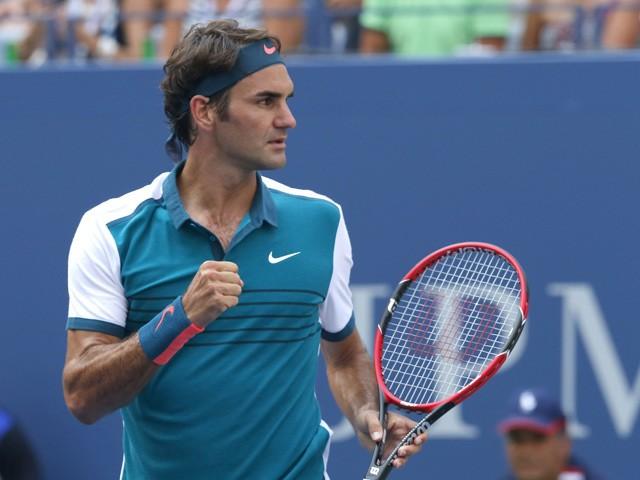 Roger Federer of Switzerland celebrates after defeating Leonardo Mayer of Argentina during their 2015 US Open Men's Singles round 1 match at the USTA Billie Jean King National Tennis Center September 1, 2015