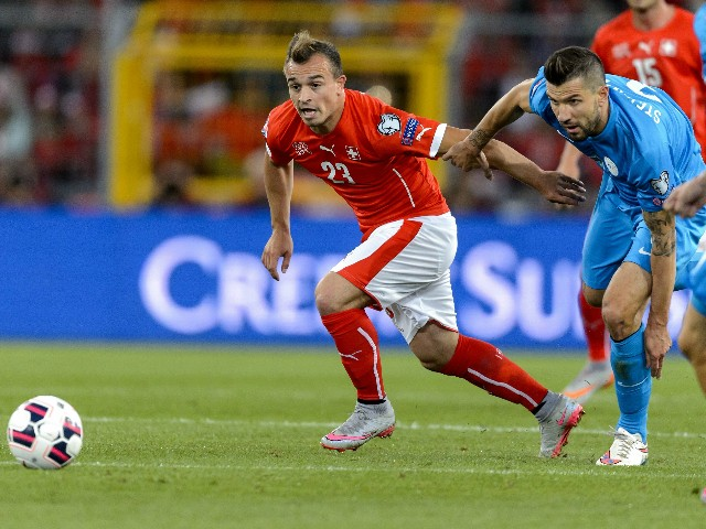 Swiss midfielder Xherdan Shaqiri (L) vies with Slovenian midfielder Dalibor Stevanovic during the Euro 2016 qualifying football match between Switzerland and Slovenia at the St. Jakob park stadium in Basel on September 5, 2015.