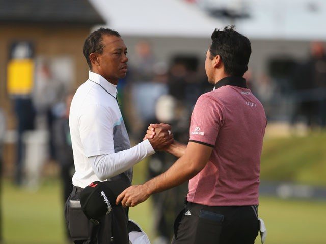 Tiger Woods of the United States and Jason Day of Australia shake hands on the 18th green during the second round of the 144th Open Championship at The Old Course on July 18, 2015