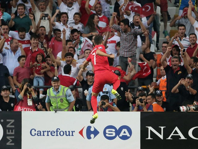 Turkey's midfielder Oguzhan Ozyakup celebrates after scoring a goal against Netherlands during the Euro 2016 qualifying football match between Turkey and Netherlands at the Arena Stadium in Konya, on September 6, 2015