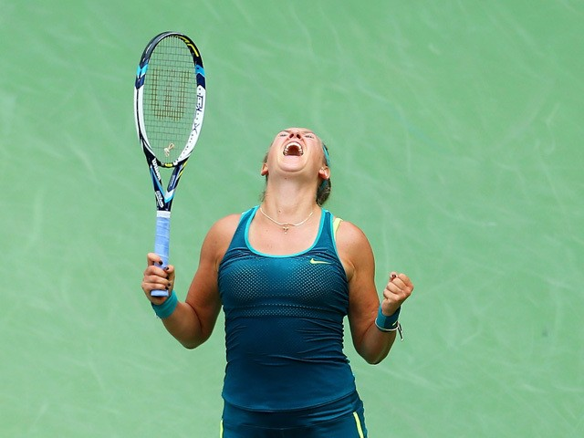 Victoria Azarenka of Belarus celebrates match point against Yanina Wickmayer of Belgium during their Women's Singles Second Round match on Day Four of the 2015 U.S. Open at the USTA Billie Jean King National Tennis Center on September 3, 2015