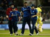 Liam Plunkett of England celebrates with James Taylor and Chris Woakes after dismissing Pat Cummins of Australia during the 3rd Royal London One-Day International match between England and Australia at Old Trafford on September 8, 2015