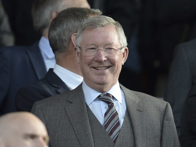 An amused Sir Alex Ferguson watches on from the stands as Manchester United host Liverpool on September 12, 2015