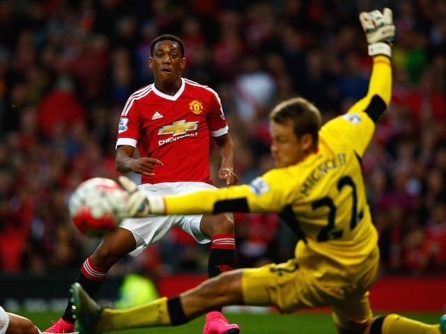 Anthony Martial sends the ball past Liverpool keeper Simon Mignolet for his first Man Utd goal on September 12, 2015