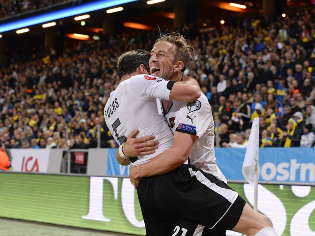 Forward Marc Janko (R) of Austria celebrates with his teammate Defender Christian Fuchs after scoring a goal during the Euro 2016 qualifying group G football match between Sweden and Austria at the Friends Arena in Solna, near Stockholm on September 8, 20