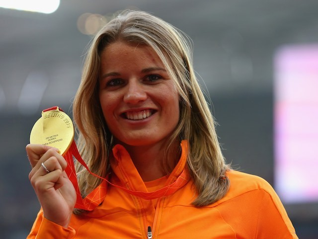 The Netherlands' Dafne Schippers poses with her gold medal in her right hand after winning the 200m at the World Championships on August 29, 2015