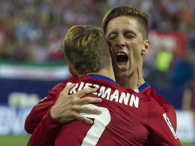 Fernando Torres shouts in Antoine Griezmann's ear after scoring for Atletico Madrid against Barcelona on September 12, 2015