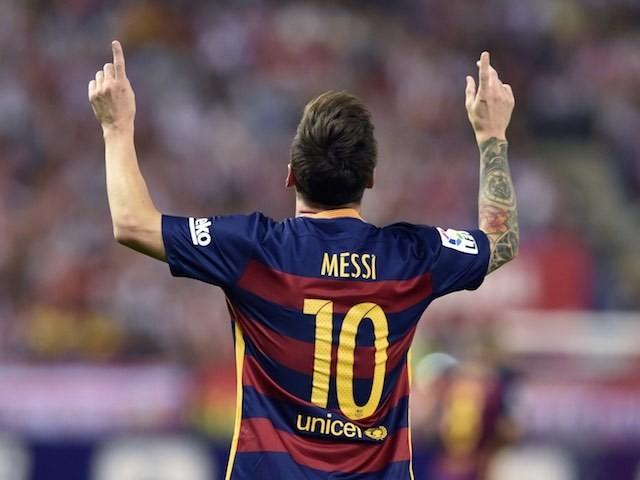 Lionel Messi celebrates scoring the winner for Barcelona against Atletico Madrid on September 12, 2015