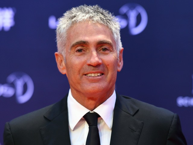 Former MotoGP driver Mick Doohan poses on the red carpet as he arrives ahead of the Laureus World Sports Award ceremony at the Grand Theater in Shanghai on April 15, 2015