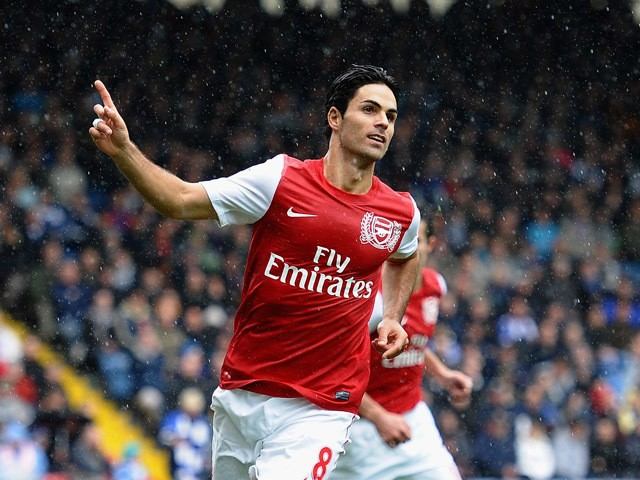 Mikel Arteta of Arsenal celebrates the second goal during the Barclays Premier League match between Blackburn Rovers and Arsenal at Ewood Park on September 17, 2011