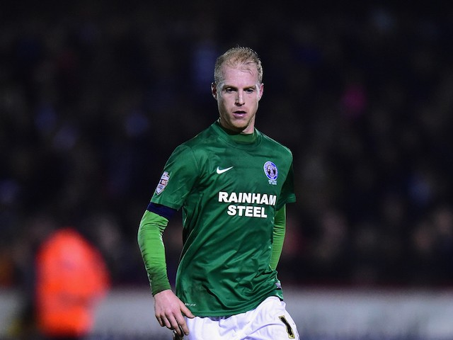 Neal Bishop of Scunthorpe in action during the FA Cup Second Round Replay between Worcester City and Scunthorpe United at Aggborough on December 17, 2014 in Worcester, England.