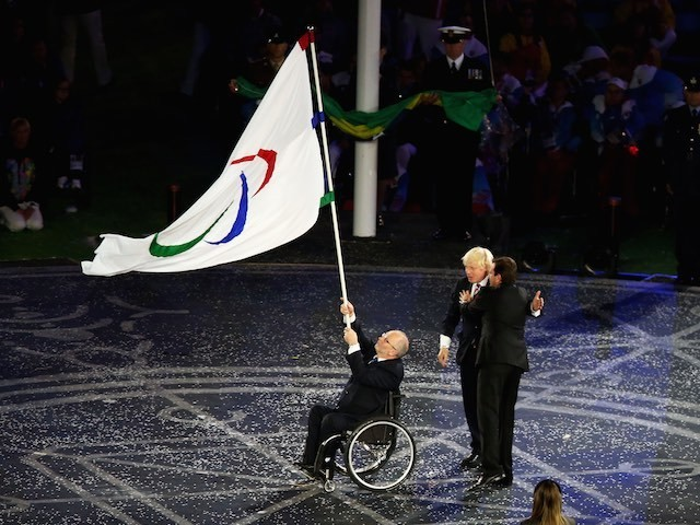 Mayor of London Boris Johnson, President of the IPC Sir Philip Craven MBE and Mayor of Rio de Janeiro Eduardo Paes perform the Paralympic flag handover ceremony during the closing ceremony on day 11 of the London 2012 Paralympic Games