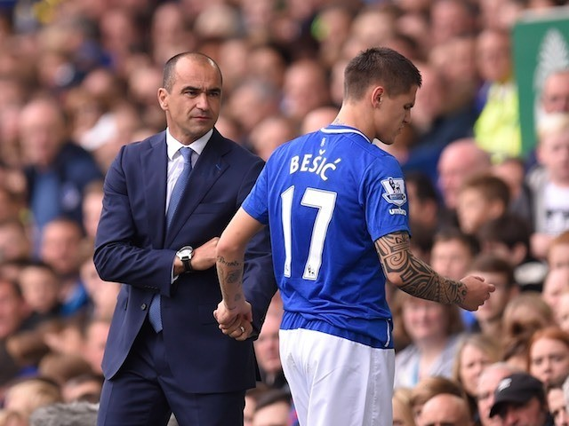 Everton boss Roberto Martinez acknowledges the injured Muhamed Besic on September 12, 2015