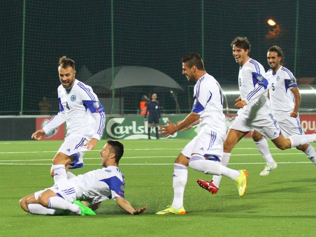 San Marino's Matteo Vitaioli celebrates after scoring with his team-mates during the UEFA Euro 2016 qualifying group E football match between Lithuania and San Marino in Vilnius on September 8, 2015