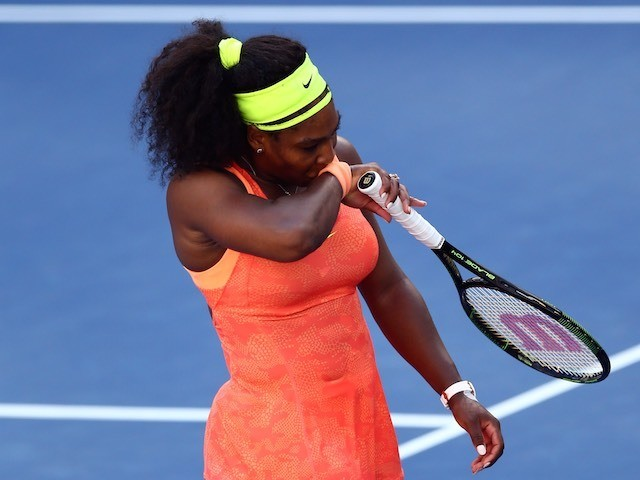 Serena Williams reacts after being knocked out of the US Open on September 11, 2015