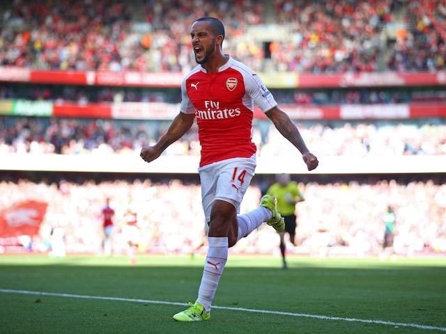 Theo Walcott celebrates scoring the opener for Arsenal against Stoke on September 12, 2015
