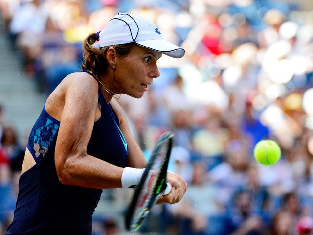 Varvara Lepchenko of the United States returns a shot to Victoria Azarenka of Belarus in their Women's Singles Fourth Round match on Day Eight of the 2015 US Open at the USTA Billie Jean King National Tennis Center on September 7, 2015