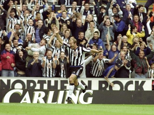 Newcastle fans celebrate as Alan Shearer scores against Sheffield Wednesday on September 19, 1999
