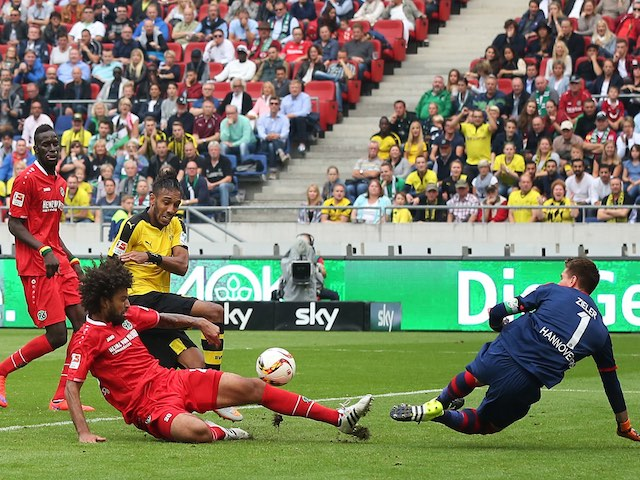 Pierre-Emerick Aubameyang scores Dortmund's third against Hannover on September 12, 2015