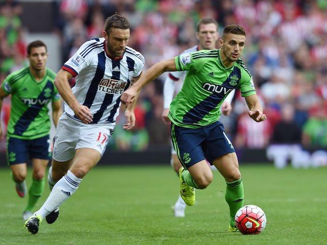 West Brom's Rickie Lambert pursues Dusan Tadic of Southampton on September 12, 2015