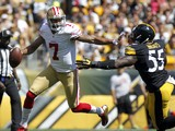 Colin Kaepernick #7 of the San Francisco 49ers avoids the rush by Arthur Moats #55 of the Pittsburgh Steelers in the first quarter during the game on September 20, 2015 at Heinz Field in Pittsburgh, Pennsylvania.