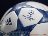 The UEFA logo is pictured on an official match ball ahead of the UEFA Champions League