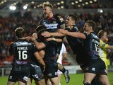 George Williams of Wigan Warriors is mobbed by teammates after scoring his second half try during the First Utility Super League match between St Helens and Wigan Warriors at Langtree Park on September 18, 2015 in St Helens, England.