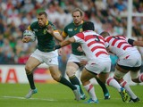 Zane Kirchner of South Africa takes on Kensuke Hatakeyama of Japan during the 2015 Rugby World Cup Pool B match between South Africa and Japan at the Brighton Community Stadium on September 19, 2015 in Brighton, United Kingdom.