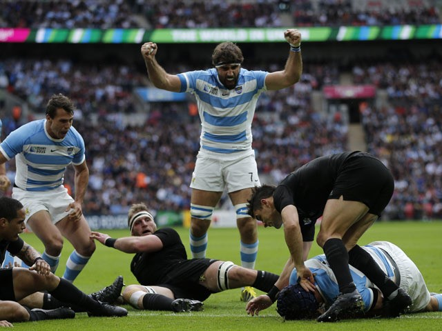 Argentina's lock Guido Petti Pagadizabal (2nd R) scores a try during a Pool C match of the 2015 Rugby World Cup between New Zealand and Argentina at Wembley stadium, north London on September 20, 2015