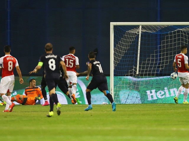 David Ospina of Arsenal looks back to see the ball hit the back of the net, an own goal by Alex Oxlade-Chamberlain of Arsenal for Zagreb's first goal during the UEFA Champions League Group F match between Dinamo Zagreb and Arsenal at Maksimir Stadium on S